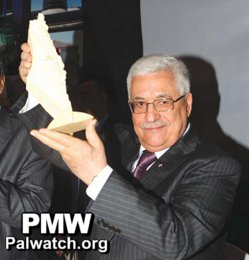 Abbas with a model of 'Palestine' covering all Israel