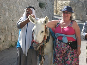 An Arab man meets us with his donkey on the Mount of Olives